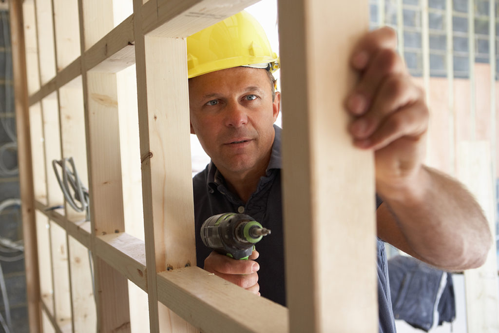 Construction Worker Reconstructing Home